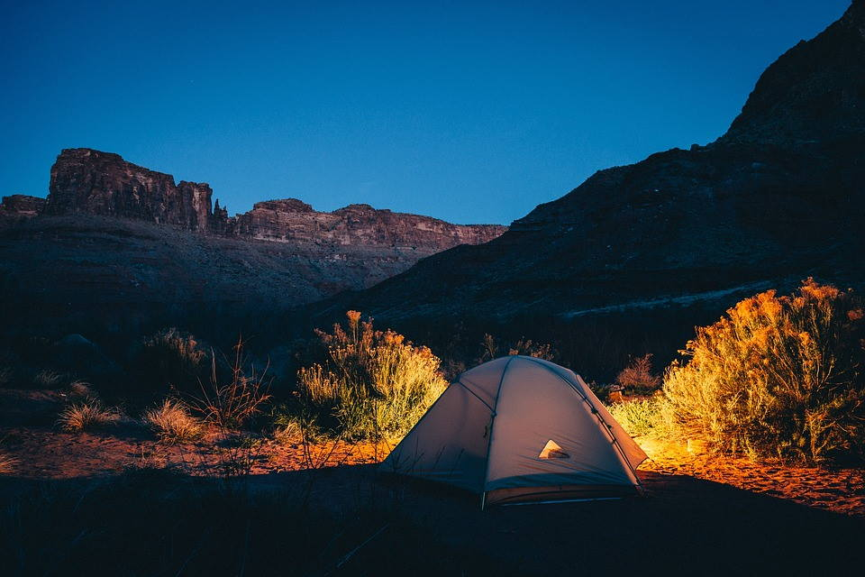 camping in a tent at night